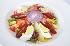 Salad with sausages on the grill Stock Images