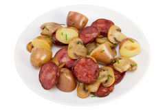 Salad with sausages on the plate Stock Photography