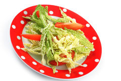 Salad savoy cabbage and tomatoes in a  plate Stock Photos