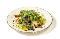 Scallop salad on a plate with cherry tomatoes and fresh herbs. stock image