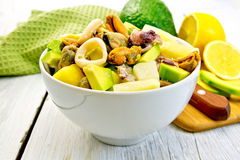 Salad seafood and avocado in bowl on light board Royalty Free Stock Photography