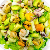 Salad seafood and avocado on top Royalty Free Stock Images