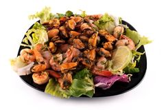A salad with seafood on a black square plate Royalty Free Stock Photography
