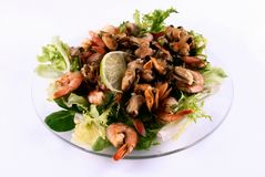 A salad with seafood on a glass plate Royalty Free Stock Photography
