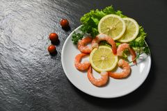 Salad seafood plate shrimps prawns ocean gourmet fresh vegetable decorate dinner table. With herbs and spices in the seafood restaurant royalty free stock photos