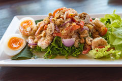 Salad Seafood Thai Style in thai restaurant. Close up thai spicy seafood salad in ceramic dish royalty free stock image