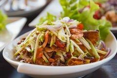 Salad Seafood Thai Style in thai restaurant. Close up thai spicy seafood salad in ceramic dish stock image