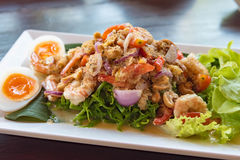 Salad Seafood Thai Style in thai restaurant. Close up thai spicy seafood salad in ceramic dish royalty free stock images