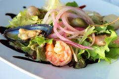 Salad with seafood. On a white plate Stock Photography