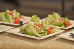 Salad is served. Fresh side salads ready to be served with dinner Royalty Free Stock Photos
