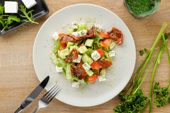 Salad served with vegetables and sauce Stock Image