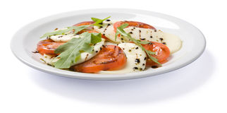 Salad served on white plate. Low angle view, isolated, with clipping path Stock Image
