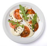 Salad served on white plate. Top view, isolated, with clipping path Royalty Free Stock Photo