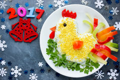 Salad shaped cock for the New Year 2017 fun food idea for holida Stock Photography