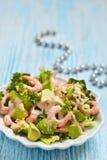 Salad with shrimp and avocado. Fresh green salad with shrimp and avocado Royalty Free Stock Photography