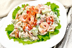 Salad with shrimp and avocado in plate on board Royalty Free Stock Image