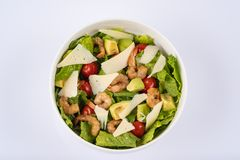 Salad of shrimp and avocado, served in white bowl stock image