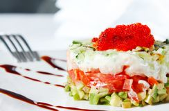 Salad with shrimp, avocado, tomatoes, red caviar Stock Photo