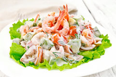 Salad with shrimp and avocado in white plate on board Royalty Free Stock Photo