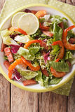 Salad with shrimp, chorizo sausage and mix lettuce close-up on a Royalty Free Stock Images