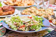 Salad with shrimp on a festive table Stock Image