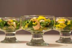 Salad with shrimp, mango and arugula Stock Photo