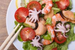 Salad of shrimp, mussels, octopus with vegetables. top view Royalty Free Stock Photos