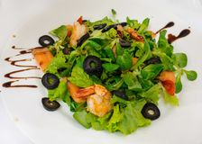 Salad from Shrimp and Salmon. Garnished with olives Royalty Free Stock Photography