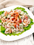 Salad with shrimp and tomato on lettuce in plate Stock Photos