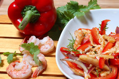 Salad from shrimps. Sharp salad from shrimps on a wooden support royalty free stock photo