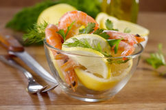 Salad with shrimps. And lemons Stock Photos