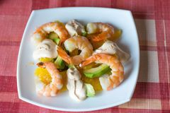 Salad with shrimps, avocodo and orange. royalty free stock image