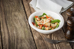 Salad with shrimps , croutons  and greens on the wooden table horizontal Stock Photos