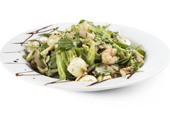 Salad with shrimps and egg. Salad with shrimps, egg, walnuts, onion & arugula Royalty Free Stock Photography