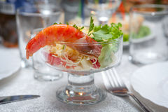 Salad with shrimps on festive table. Royalty Free Stock Image