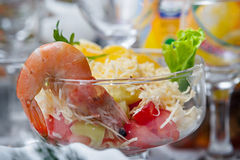 Salad with shrimps on festive table. Stock Image