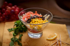 Salad with shrimps, olives, corn. Delisious Salad with shrimps, olives, corn in glass Stock Image