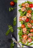 Salad with shrimps or prawn, tomato and arugula Royalty Free Stock Photo