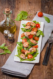 Salad with shrimps or prawn, tomato and arugula Royalty Free Stock Photography