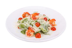 Salad with shrimps, tomato and Parmesan cheese. On white background Stock Photography
