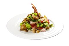 Salad `Slavkovsky`. Warm salad with bacon, potatoes, greens and mushrooms stock photo