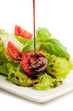 Salad with Slice tomato and basil royalty free stock images