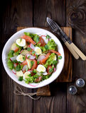 Salad from slightly salted salmon, boiled potatoes, quail eggs with cucumber and radish. Stock Images