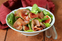Salad with smoked ham and fresh figs Royalty Free Stock Photography