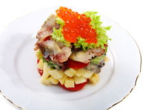 Salad with smoked herring and salmon roe. Stock Photography