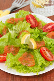 Salad with smoked salmon and tomato Stock Photos