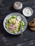 Salad with smoked turkey, cucumber and boiled egg on a dark wooden background. Royalty Free Stock Photos