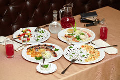 Salad and snacks in restaurant served for two persons Stock Photo