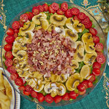 Salad with spicy bacon, mushrooms and cherry tomatoes Royalty Free Stock Image