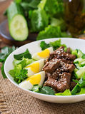 Salad with spicy beef, cucumber and eggs. Stock Images